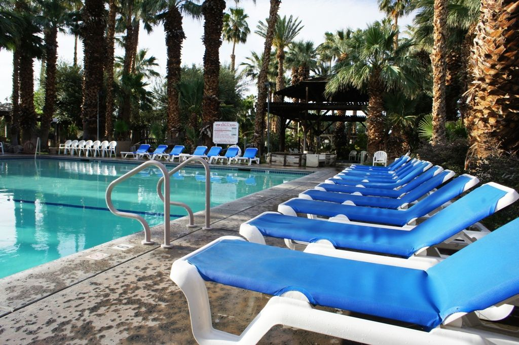 Relax in lounge chairs at our refreshing Palm Springs area pool